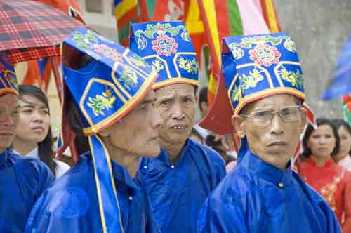men in blue hats-AsiaPhotoStock