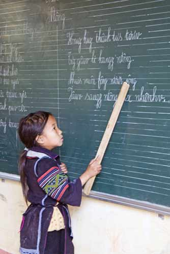 hmong child teaches-AsiaPhotoStock