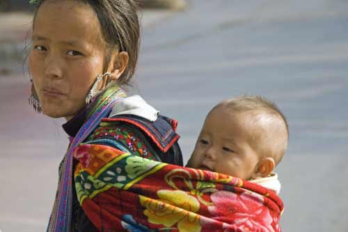 hmong child carrying-AsiaPhotoStock