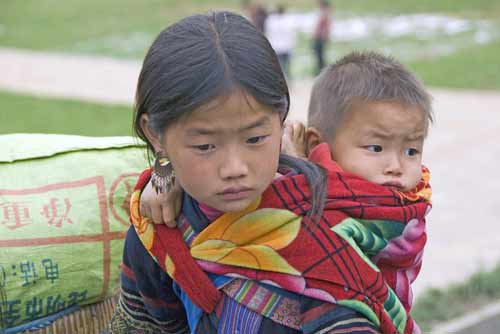 sister carrying brother-AsiaPhotoStock