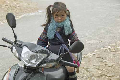 girl on motor bike-AsiaPhotoStock