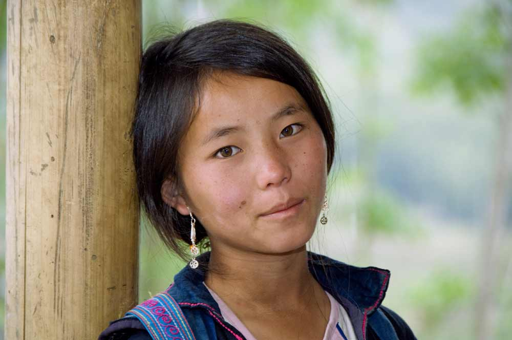 hmong girl relaxes-AsiaPhotoStock