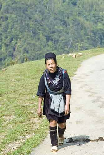 hmong lady walking-AsiaPhotoStock