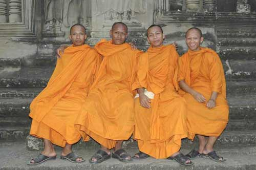 four happy monks-AsiaPhotoStock