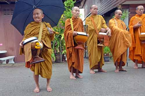 alms and monks-AsiaPhotoStock