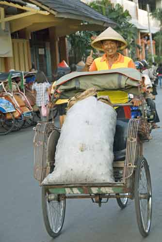 becak load-AsiaPhotoStock