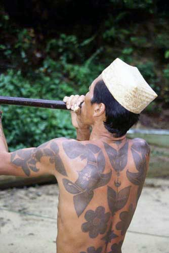 Malay iban with blowpipe-AsiaPhotoStock