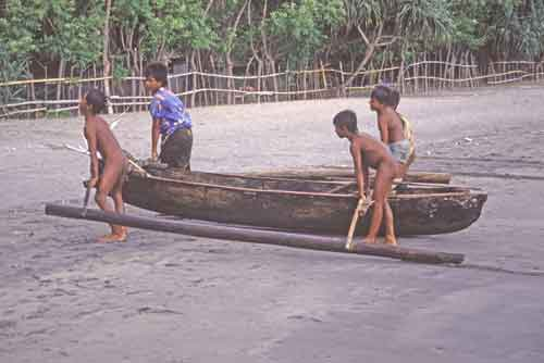 boys carrying boat-AsiaPhotoStock