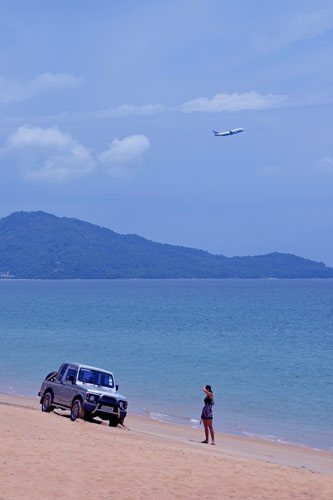 car on maikhao beach-AsiaPhotoStock