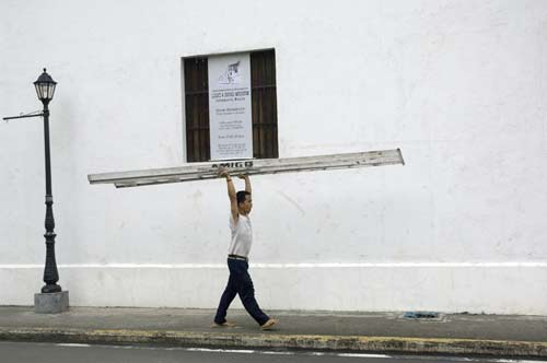 carrying a ladder-AsiaPhotoStock