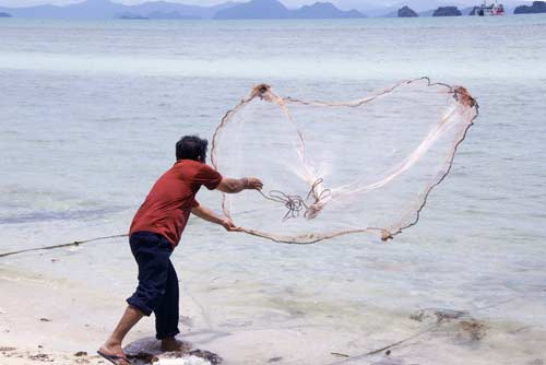 casting fishing net-AsiaPhotoStock