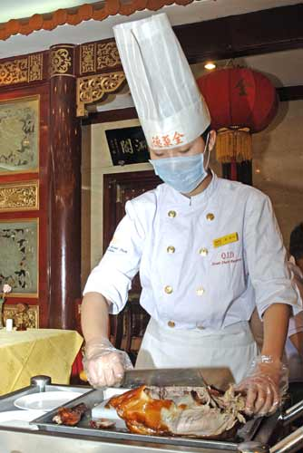 peking duck carving-AsiaPhotoStock
