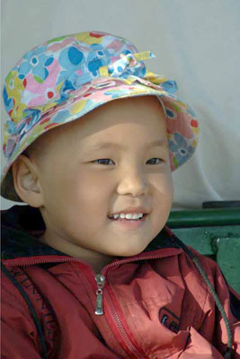 child with hat-AsiaPhotoStock