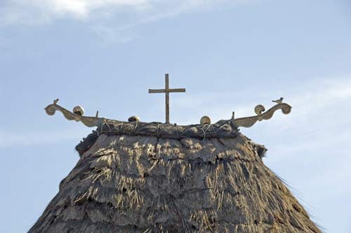 cross on thatch-AsiaPhotoStock