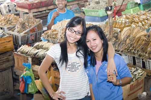 girls by dried fish-AsiaPhotoStock