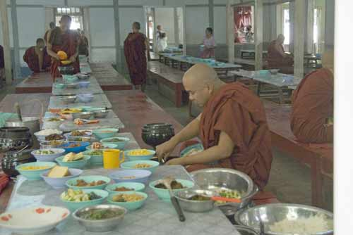 monk eating alone-AsiaPhotoStock