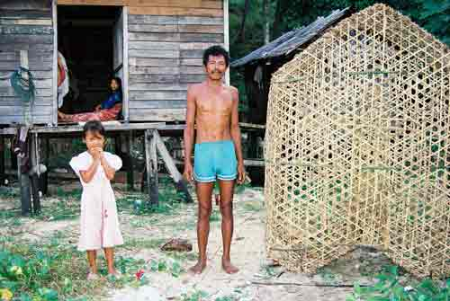 family with fish trap-AsiaPhotoStock