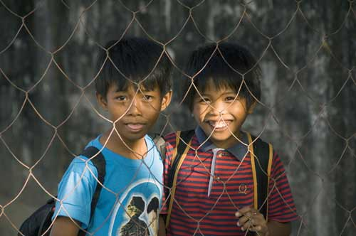 boys behind fence-AsiaPhotoStock