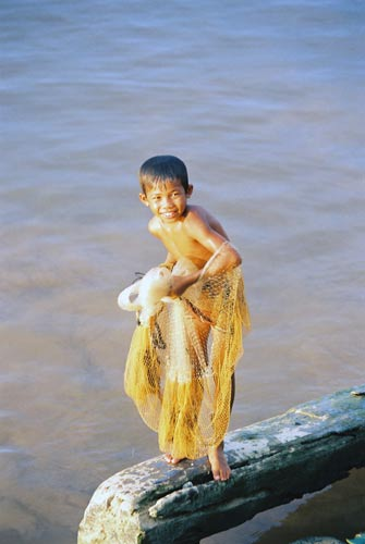 boy fishing with net-AsiaPhotoStock