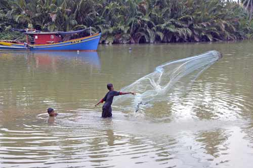 fishing with net-AsiaPhotoStock