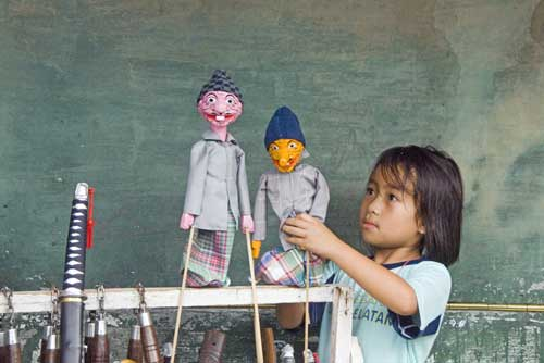 girl with puppets-AsiaPhotoStock