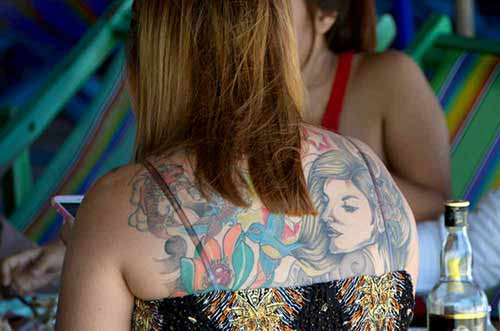 girl tattoo-AsiaPhotoStock