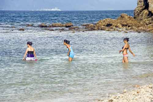 three girls wading-AsiaPhotoStock