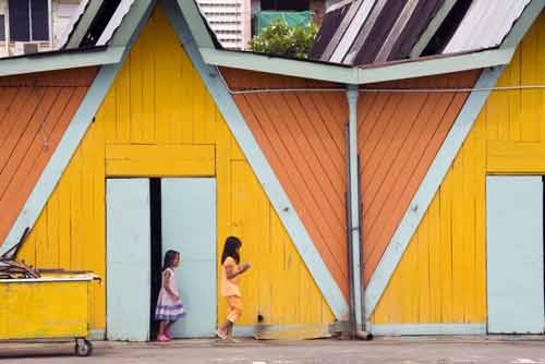 girls by yellow wall-AsiaPhotoStock