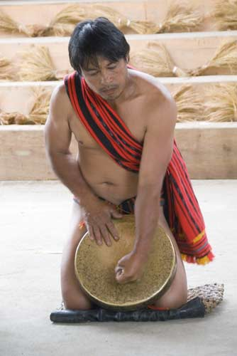 man playing a gong-AsiaPhotoStock