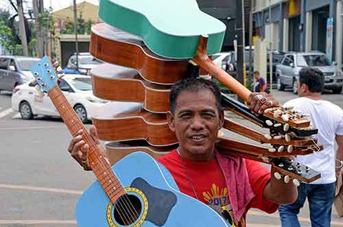 guitar man in cebu-AsiaPhotoStock