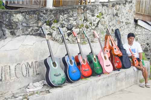guitars on wall-AsiaPhotoStock