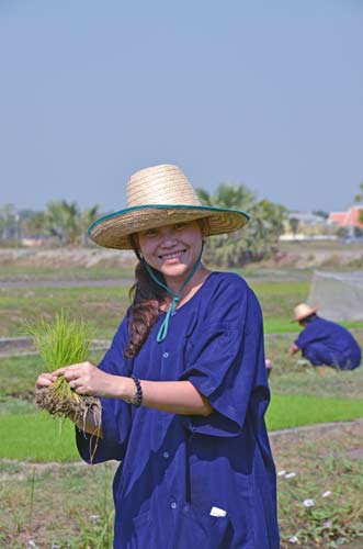 happy farmer with rice-AsiaPhotoStock