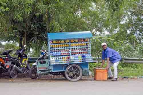 hawker with cart-AsiaPhotoStock