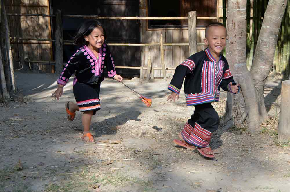 hmong kids playing chase-AsiaPhotoStock