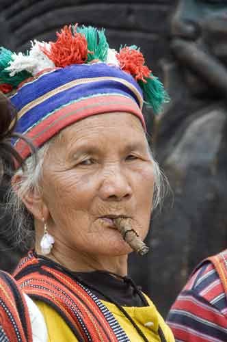 igorot lady and cigar-AsiaPhotoStock