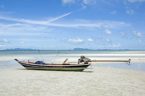 long tail boat on beach-AsiaPhotoStock