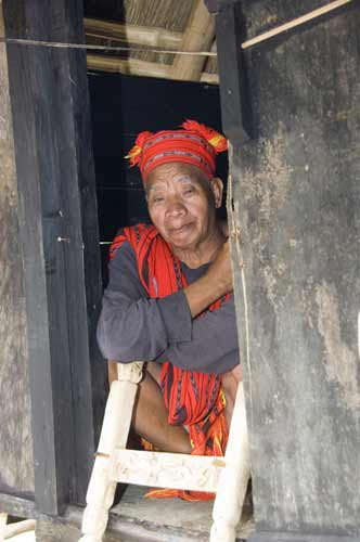 ifugao sitting in hut-AsiaPhotoStock