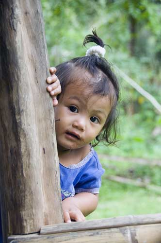 mangyan child peeping-AsiaPhotoStock