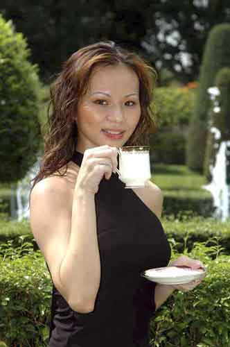 model drinking tea-AsiaPhotoStock