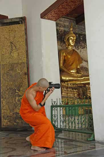 monk with camera-AsiaPhotoStock