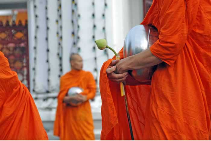 monk with lotus flower-AsiaPhotoStock