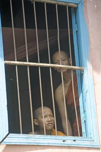 monks at window-AsiaPhotoStock