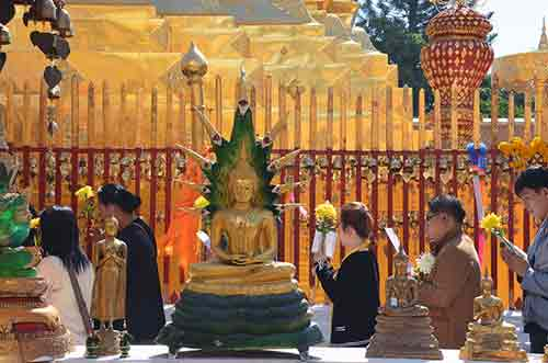 praying at doi suthep-AsiaPhotoStock