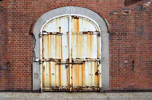 red brick warehouse door-AsiaPhotoStock