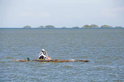 rowing bamboo raft-AsiaPhotoStock