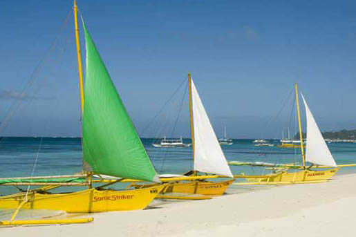 sails at white beach-AsiaPhotoStock