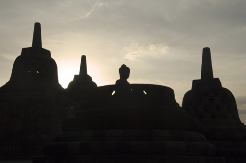 silhouetted buddha-AsiaPhotoStock