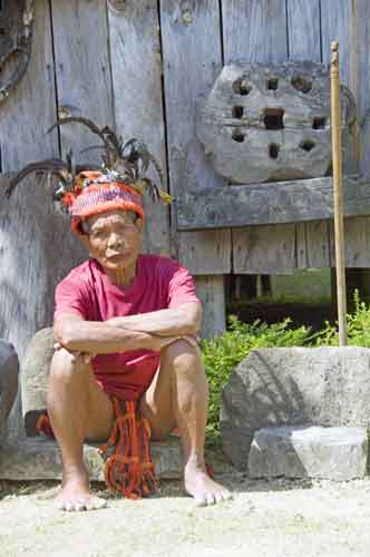 ifugao sits by his house-AsiaPhotoStock