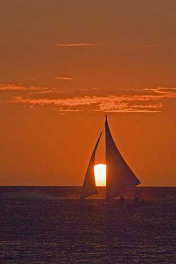 sun setting between sails-AsiaPhotoStock