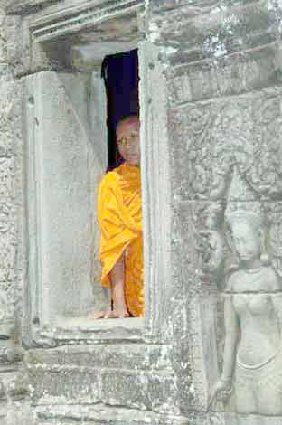 monk at ta prohm-AsiaPhotoStock